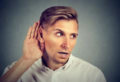 Curious man listening to conversation news eavesdropping Stock Photos