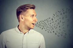 Man talking with alphabet letters coming out of his mouth Stock Photos