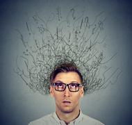Man with worried face expression brain melting into lines question marks Stock Photos