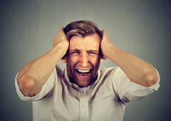 Stressed man upset frustrated screaming Stock Photos