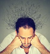 Sad man with stressed face expression brain melting into lines Stock Photos