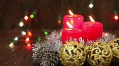 Christmas arrangement. Burning candles and Christmas decorations. Background - stock footage