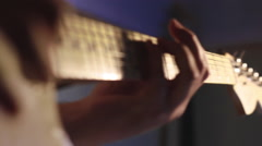 A man playing fast solo on electric guitar in the recording studio Stock Footage