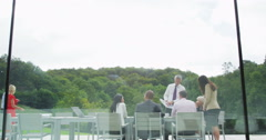 4K Business team in outdoor meeting seen through the glass of modern building Stock Footage
