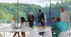 4K Diverse medical team in a meeting in modern glass building Stock Footage