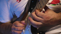 The man playing solo on electric guitar in the recording studio close-up Stock Footage
