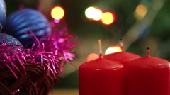 A man lights a Christmas candle. Christmas background Stock Footage