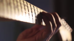 A man playing fast solo on electric guitar in the recording studio neck close-up Stock Footage