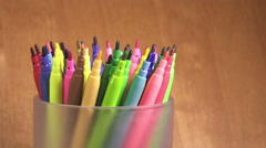 Felt-tip pens are rolled in a support Stock Footage