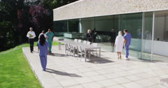 4K Diverse medical team walking outside modern health care facility Stock Footage