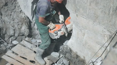 Worker repairing the construction collector Stock Footage