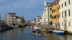 Chioggia - Old boat and traditional houses along the Vena bridge Stock Footage