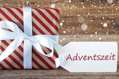 Present With Snowflakes, Text Advetszeit Means Advent Season Stock Photos