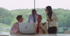4K Diverse business team working together in modern glass office Stock Footage
