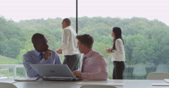 4K 2 Businessmen working together in modern glass office Stock Footage