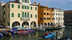Chioggia - Boat and traditional houses along the Vena bridge Stock Footage
