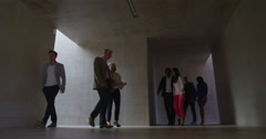 4K Group of people walking in different directions through modern building Stock Footage