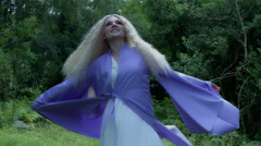 4k Fantasy Shot of a Fairy spinning Happy in the Forest Stock Footage