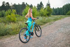 Sport woman with bike enjoy summer vacation, active lifestyle Stock Photos