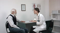 Patient tells the doctor about his health complaints Stock Footage