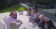 4K Diverse business team in outdoor meeting outside modern building Stock Footage