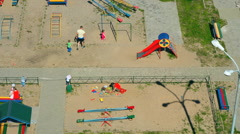 Babies playing on the children's playground Stock Footage