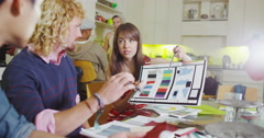 4K Creative fashion design team looking at fabric swatches & discussing ideas Stock Footage
