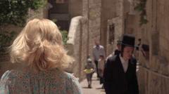 IZRAEL, JERUSALEM - 7 JUNE 2016: Woman tourist walking on the streets of Stock Footage