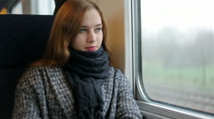 Woman look in window inside train, think and smile Stock Footage