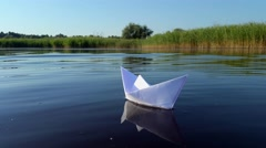 Ship of white paper floating in the river Stock Footage