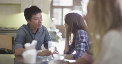 4K Happy friends socializing with drinks & young couple chatting & flirting Stock Footage