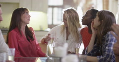 4K Happy female friends chatting over drinks at relaxed social event with friend Stock Footage