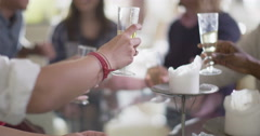 4K Happy young friends chatting over drinks at relaxed social event Stock Footage