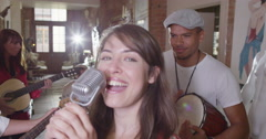 4K Happy funky hipster friends in a band, singing & playing instruments Stock Footage