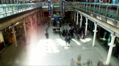 Time lapse of travelers and commuters passing through London's St. Pancras Stock Footage