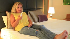 Woman relaxing with television in the bedroom 2 Stock Footage