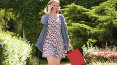 Young woman shopping trip Stock Footage