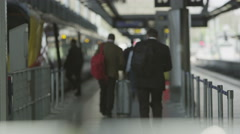 Travelers and commuters on the platform at London's St. Pancras Stock Footage