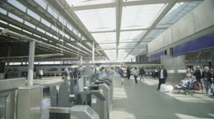 Travelers and commuters on the concourse at London's St. Pancras railway station Stock Footage
