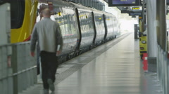 Travelers and commuters on the platform at London's St. Pancras railway station Stock Footage