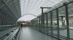 Interior view of St. Pancras railway station, London featuring the glass ceiling Stock Footage