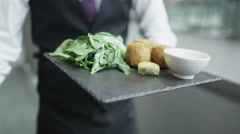 Waiter in a restaurant brings a delicious fresh dish to the table Stock Footage
