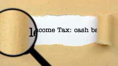 Magnifying glass on income tax Stock Footage