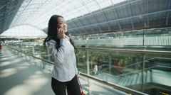 Beautiful young woman traveling on her own makes a phone call Stock Footage