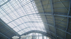 Interior view of passengers walking through St. Pancras railway station in Stock Footage
