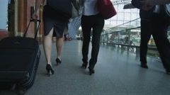 2 attractive young professional women walking together through St. Pancras Stock Footage