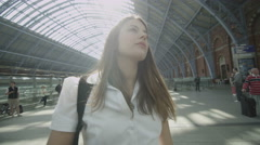 Attractive woman traveling on her own waits at St. Pancras railway station Stock Footage
