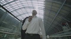 Businessman walking through St. Pancras railway station in London Stock Footage