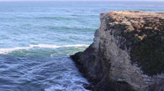 Cliff and waves crashing three Stock Footage