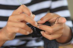 Close up of hands crocheting Stock Photos